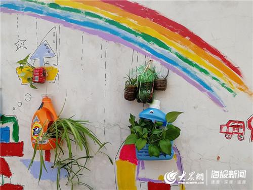 废物利用美化家园,争当环保小卫士 日照市浮来春小学教育进社区活动